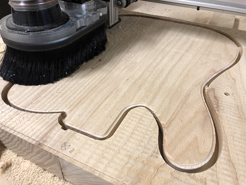 Cutting an electric guitar body on a CNC