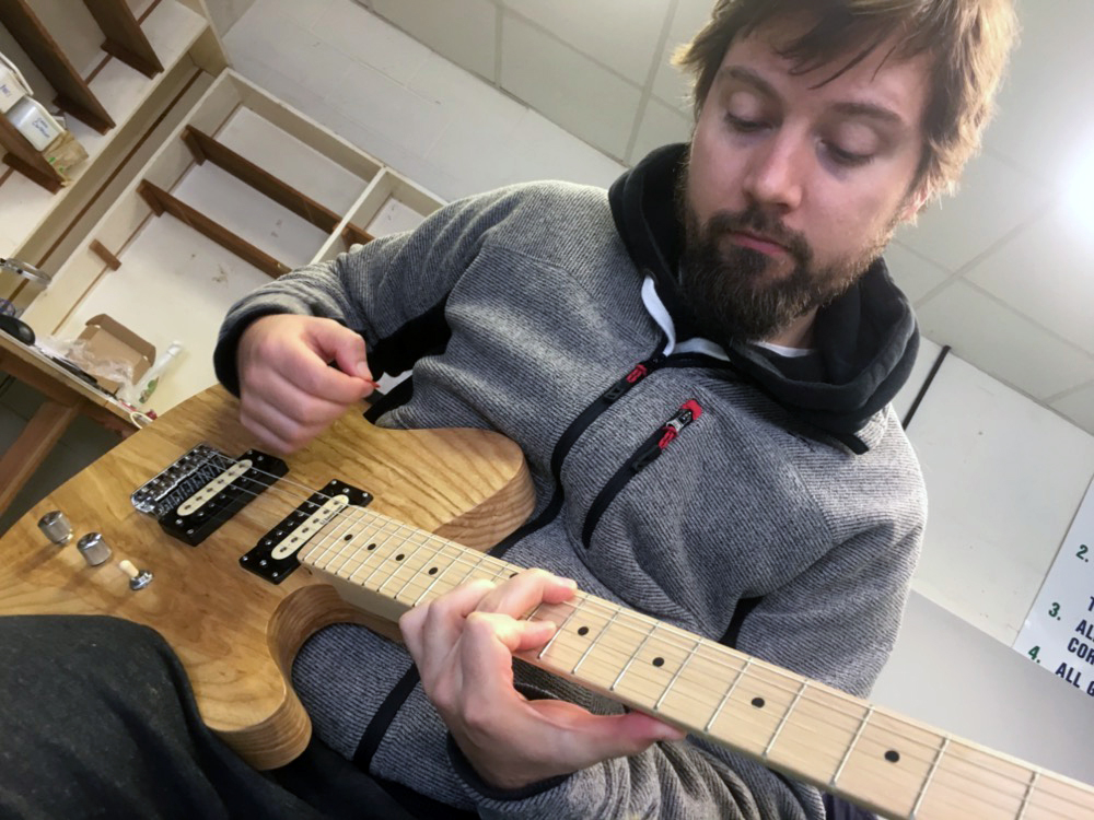 Jonathan playing a Munson custom shop guitar
